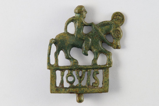 Fig. 10: Bronze military brooch dedicated to Jupiter, mid-third century AD. Credit: The Provinciaal Archeologisch Museum Velzeke
